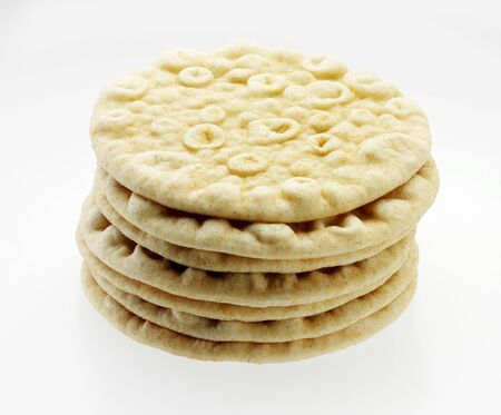 several breads: Stack of Pita Breads on a White Background