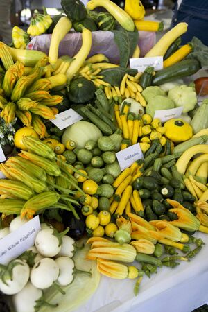 courgettes: Courgettes and squashes on a market stall