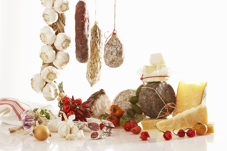 southern european: A still life featuring Italian sausage and cheese varieties LANG_EVOIMAGES