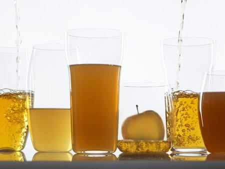 clarify: Assorted clear and cloudy apple juices in glasses LANG_EVOIMAGES