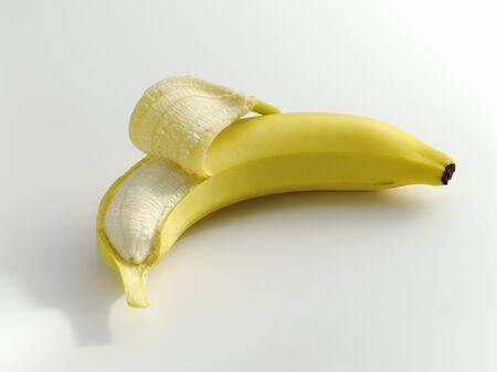 peeled banana: A partly peeled banana