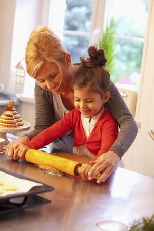 3 4 length: A mother and daughter rolling dough for Lebkuchen (spiced soft gingerbread from Germany)