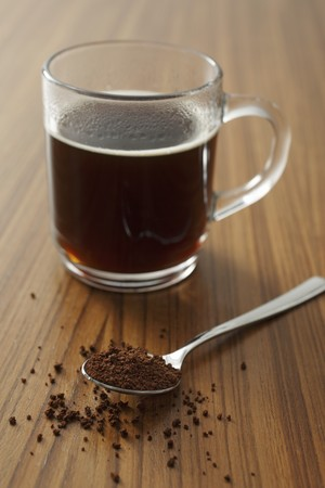 hot coffees: A cup of instant coffee and a spoonful of instant coffee powder LANG_EVOIMAGES