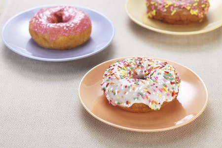 jimmies: Doughnuts with colourful glaze and sugar sprinkles LANG_EVOIMAGES