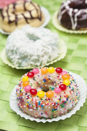 dragees: Frosted Doughnut with Sprinkles and Candies; Assorted Doughnuts