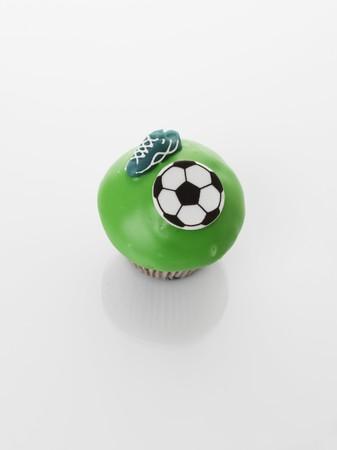 futbol infantil: Una magdalena verde decorado con motivos de f�tbol