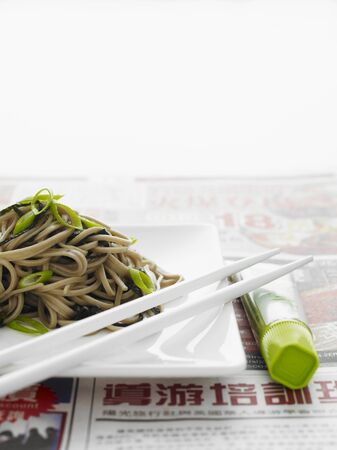 soba noodles: Japanese soba noodles on a white plate with white chopsticks LANG_EVOIMAGES