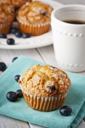 blueberry muffin: Blueberry Muffin with a Cup of Coffee LANG_EVOIMAGES