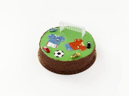 futbol infantil: Una torta de cumplea�os decorada con motivos de f�tbol