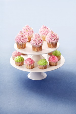 buttercream: Cupcakes decorated with buttercream and sugar crystals on a cake stand