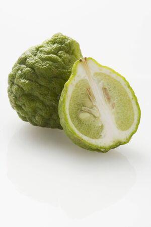kafir lime: Kefir limes, whole and halved