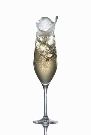squirted: Champagne splashing out of a glass