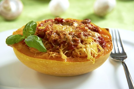 Spaghetti squash filled with tomato sauce and mushrooms, topped with cheese and baked LANG_EVOIMAGES