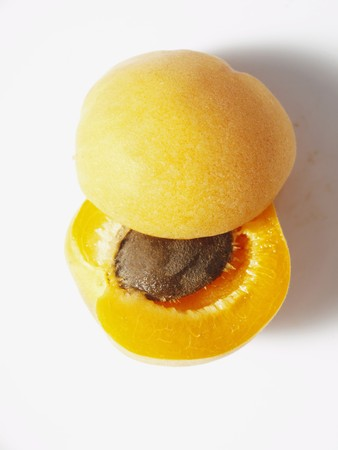 apricot kernel: An apricot cut in half to reveal the stone