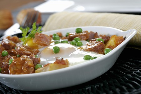 andalusian cuisine: Spanish potatoes with chorizo in a pan (Andalusia)