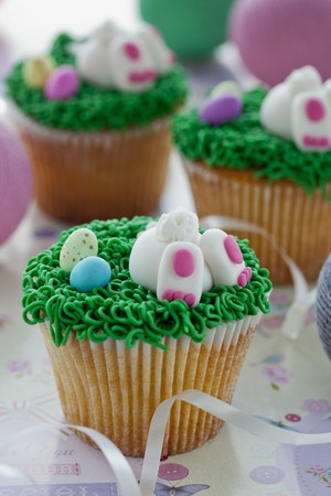buttercream: Vanilla cupcakes with buttercream and sweet Easter-themed decorations