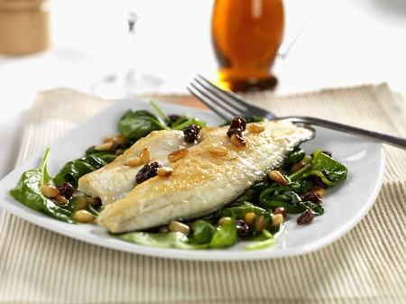 pine kernels: pan fried sea bass with wilted spinach, roasted pine nuts and sultanas