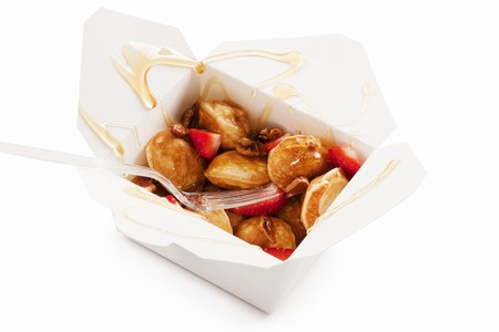 take out: Mini Pancakes with Strawberries and Syrup in a Take Out Container LANG_EVOIMAGES