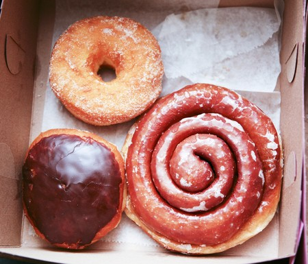 take out: Three Assorted Doughnuts in a Cardboard Take Out Box LANG_EVOIMAGES