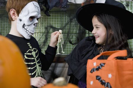 10 to 12 year olds: Little boy and girl at a Halloween party
