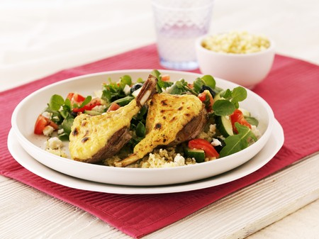Gratinated lamb chops with a mixed leaf salad, courgettes, tomatoes and couscous LANG_EVOIMAGES