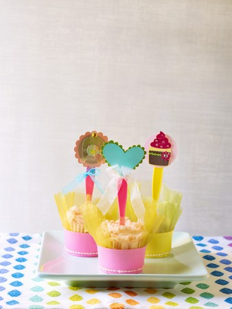 childs birthday party: Cupcakes with Paper and Ribbon Decorations