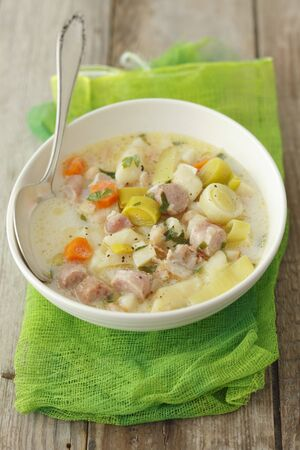 veal sausage: Soup with veal sausage, leek and gnocchi