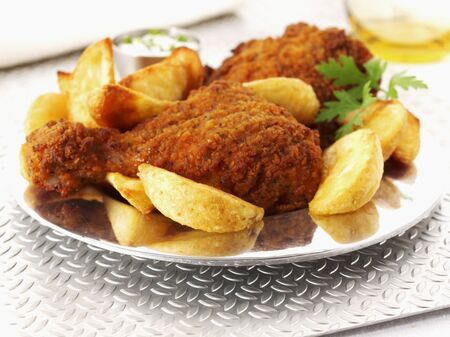 potato wedges: Spicy breaded chicken legs with potato wedges