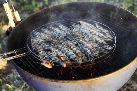 qs: Sardines being barbecued