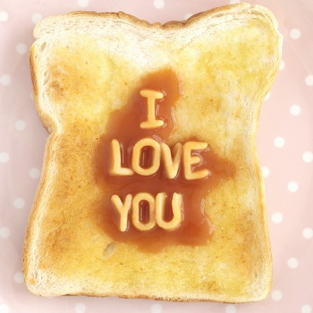 i love u: A slice of toast with spaghetti letters spelling out I LOVE YOU