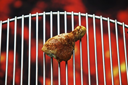 studio b: A chicken drumstick on a barbecue