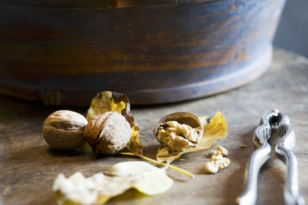 pit fall: Whole and cracked walnuts with a nutcracker