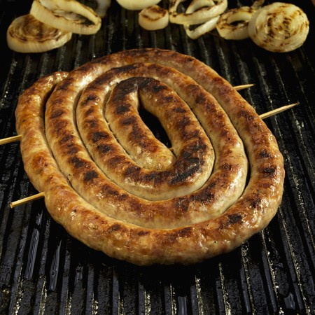 qs: Coil of Italian Sausage on Grill with Onions