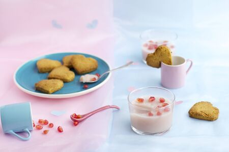 scattered in heart shaped: Cardamom biscuits and rose and pomegranate panna cotta LANG_EVOIMAGES