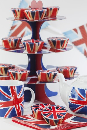 stand teapot: Union Jacks on cupcakes, a cake stand, a teapot and tea cups LANG_EVOIMAGES