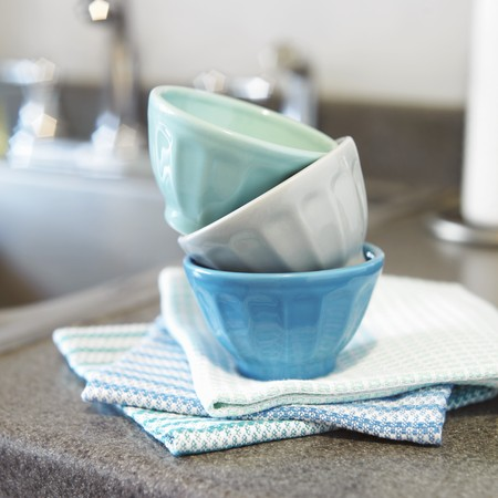 worktops: Small Prep Bowls Stacked on Kitchen Towels on a Kitchen Counter