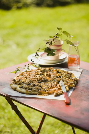 goat peach: Peach Jam Pizza with Goat Cheese, Nuts and Blueberries; On an Outdoor Table; Blueberry Branch in a Bottle LANG_EVOIMAGES