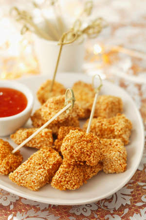 coatings: Chicken with a sesame crust and chilli sauce