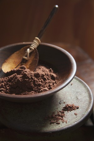 brownish: Coco Powder in a Brown Bowl with Wood Spoon