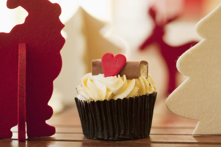 christmassy: Christmassy cupcake with a red heart