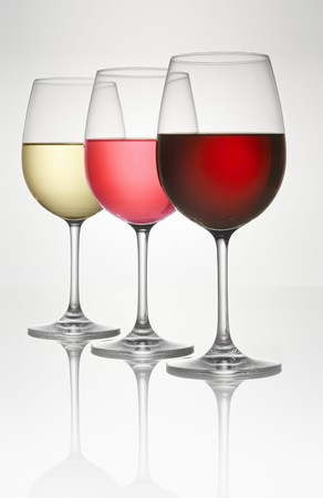 cut through: Three wine glasses (of white, rosé, and red wine)