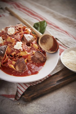 short pasta: Pappardelle pasta with short rib ragu, made from roasted pork bones, tomatoes, herbs and spices.