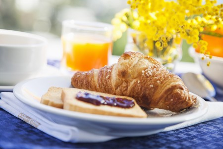 mat like: A breakfast of croissant, rusk and fresh orange juice LANG_EVOIMAGES