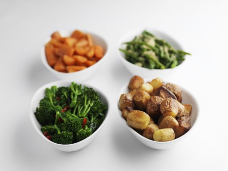 broccolli: Side dishes of steamed vegetables and roast potatoes.