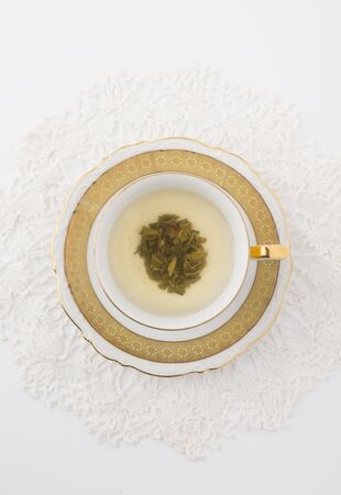 teaset: Cup of Green Tea on White
