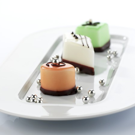 petit: Three different petit fours with silver pearls