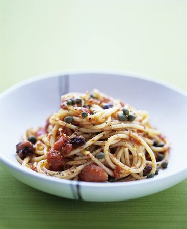 puttanesca: Spaghetti puttanesca with tomatoes and olives LANG_EVOIMAGES