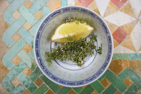 lemon wedge: Thyme and a lemon wedge in a bowl