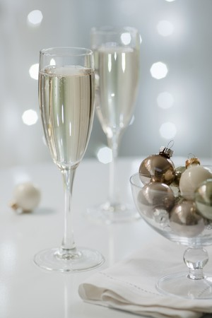 champers: Two glasses of sparkling wine with Christmas decorations