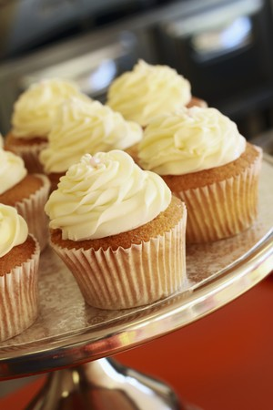 buttercream: Buttercream cupcakes on a cake stand